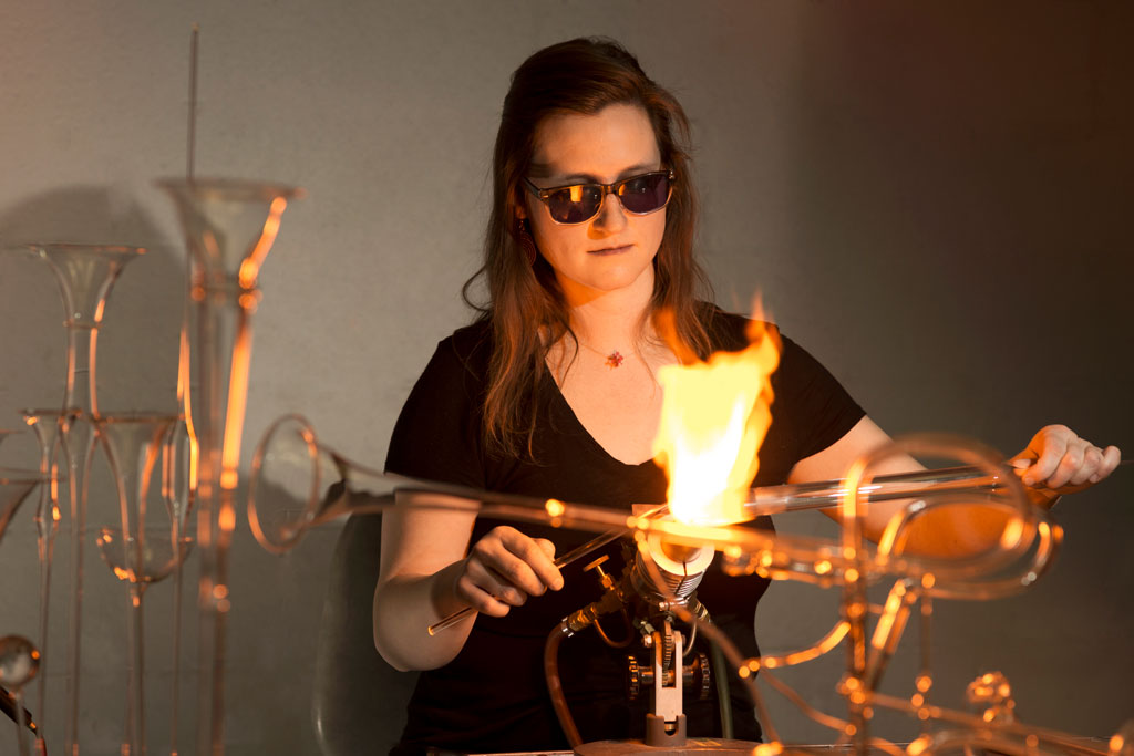 Madeline Rile Smith making a glass trumpet on the torch.