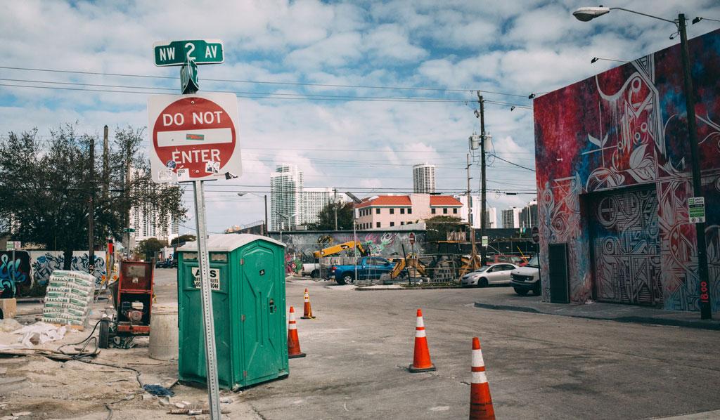 A street scene from Miami-Dade Florida. traffic cones, graffiti