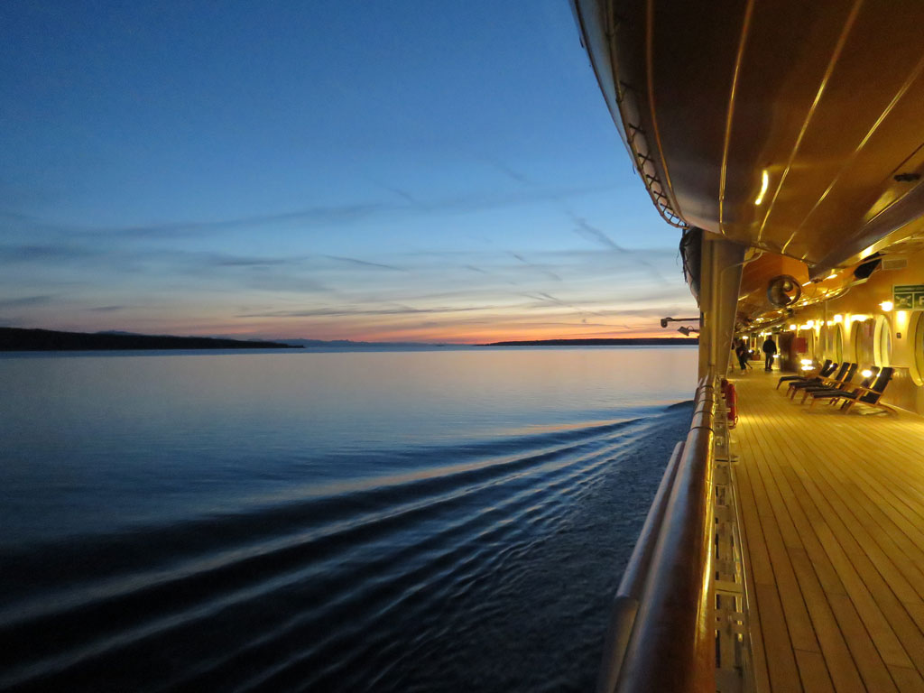 View from the deck of an ocean liner at sunset