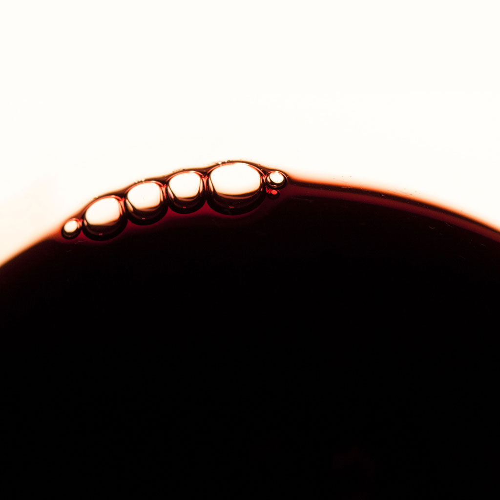 red liquid with bubbles, close up