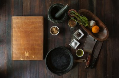 cutting board, spices, and a cleaver