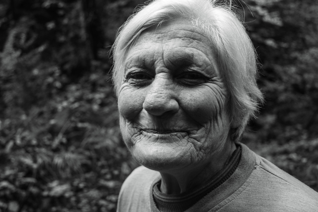 greyscale portrait of older woman