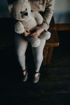 young girl holding a teddy bear