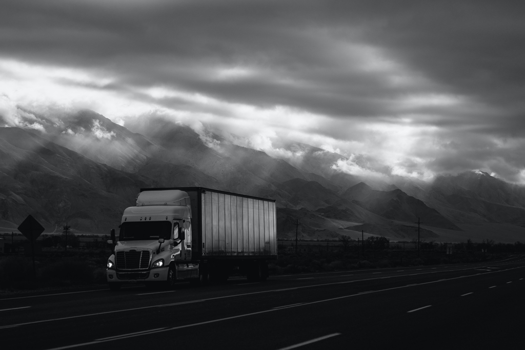 b/w photo of a truck on a highway