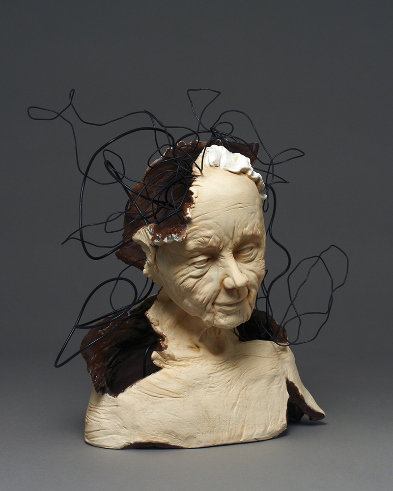 Bust (sculpture) of a woman with large red wounds and black wires coming out of them