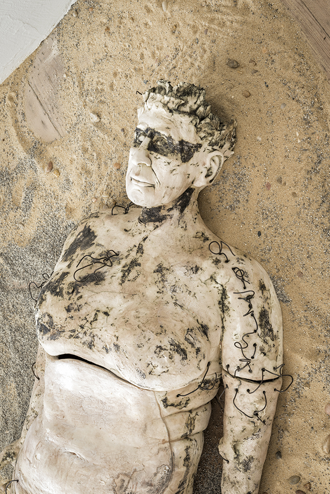 Close up of head and chest of sculpted body